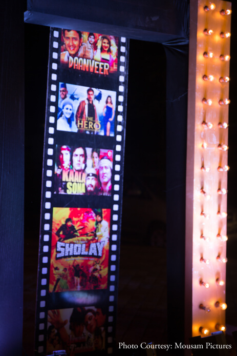 'Bollywood' was the theme for our sangeet and we created a red carpet vibe with lots of yellow bulbs and movie posters