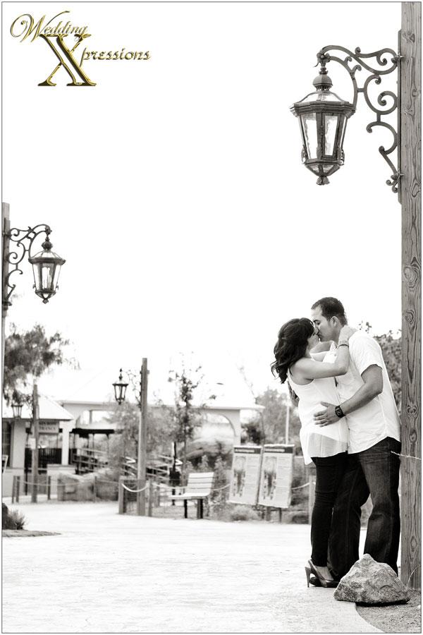 engagement kiss next to light post