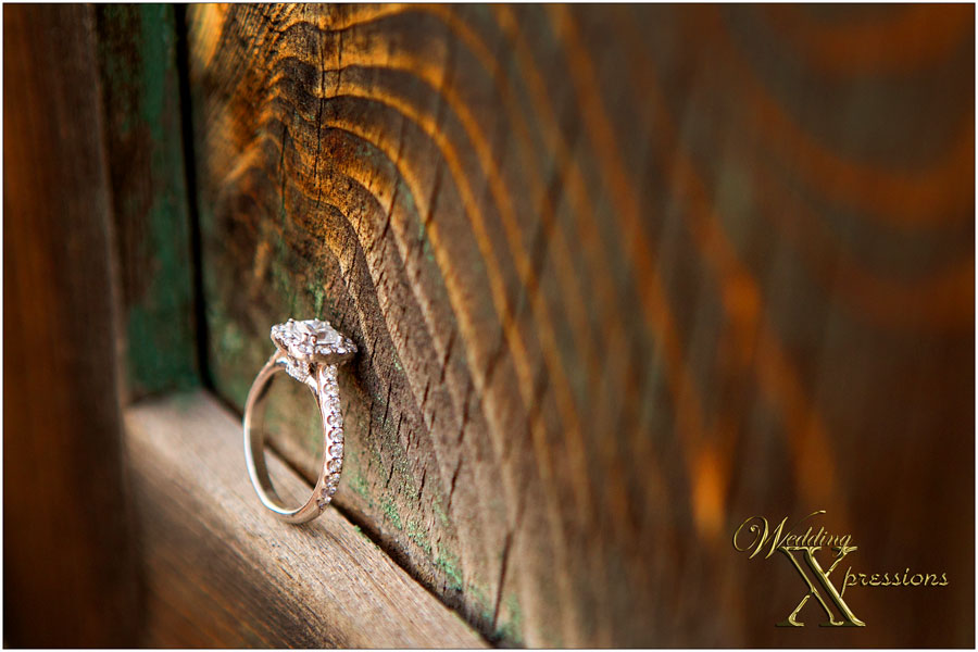 engagement ring on wood background