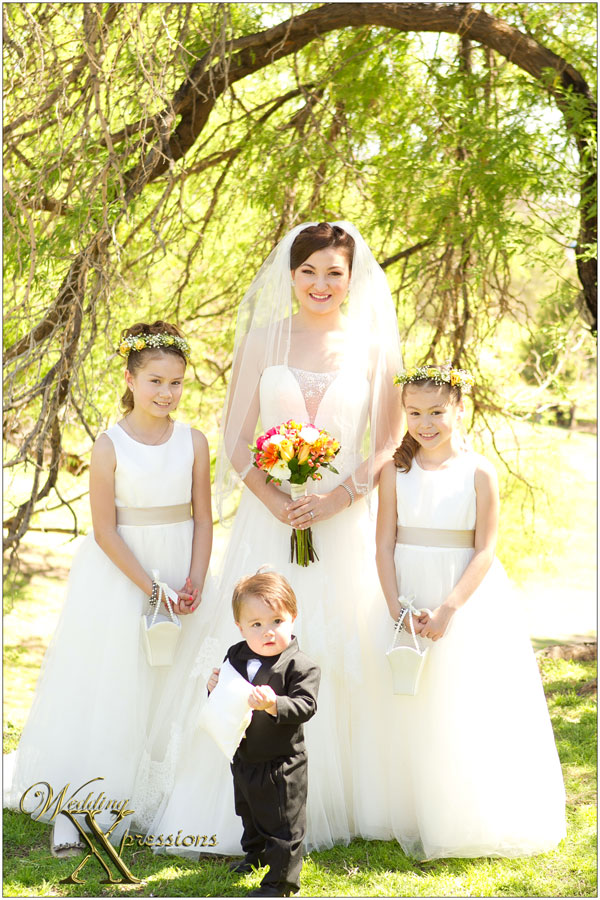 bride with flower girls and ring bearer