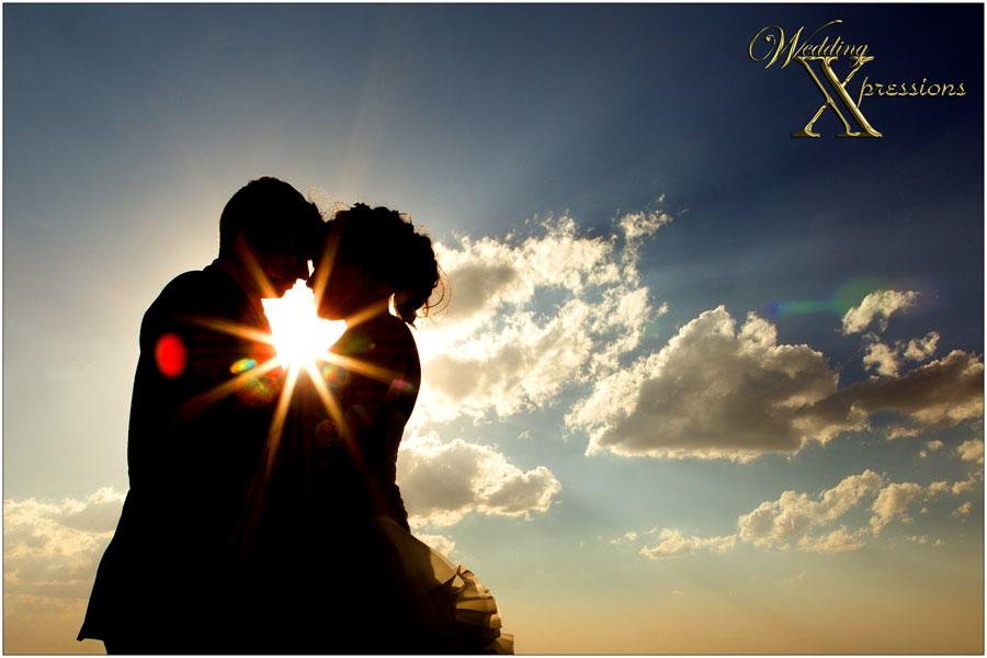 silhouette of bridal couple over beautiful El Paso sky