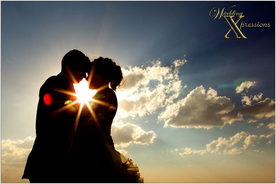 silhouette of bridal couple over beautiful El Paso sky