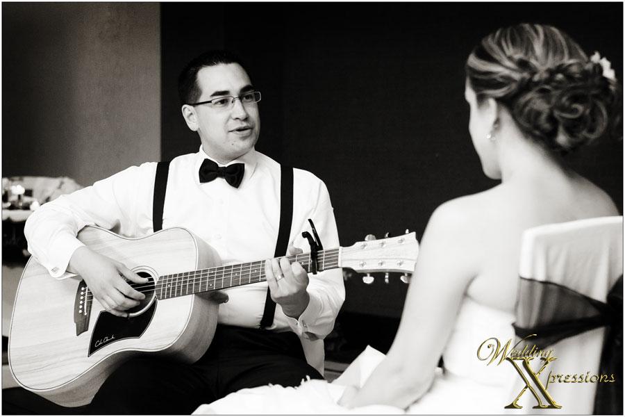 groom sings song to bride