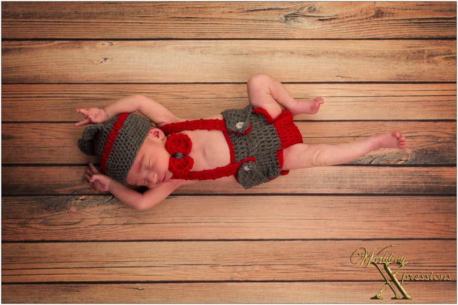 baby with red and grey outfit