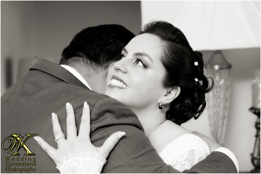 bride hugging brother with tears running down cheek