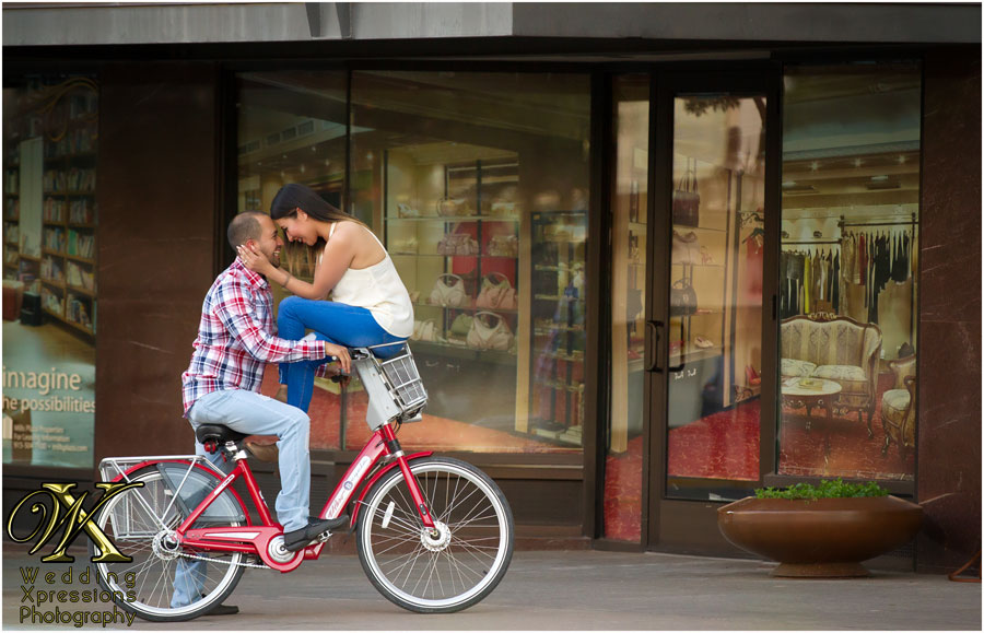 engaged couple on a bike