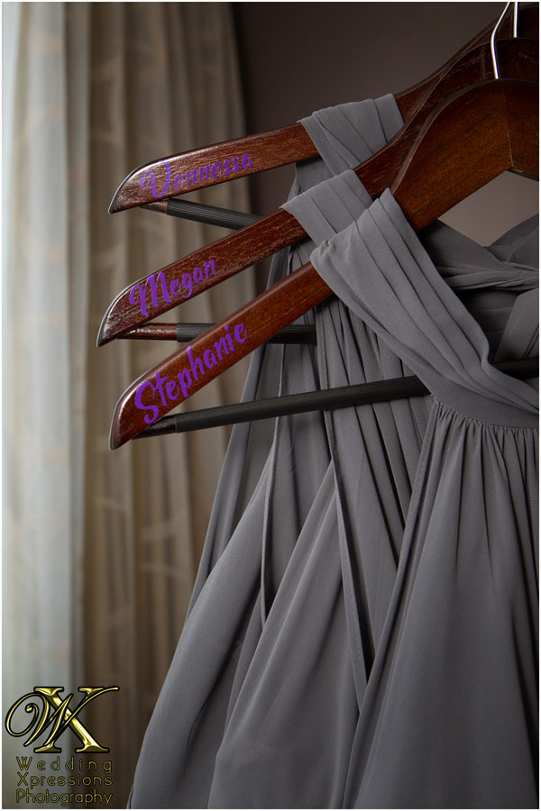 bridesmaids dresses with names on hangers