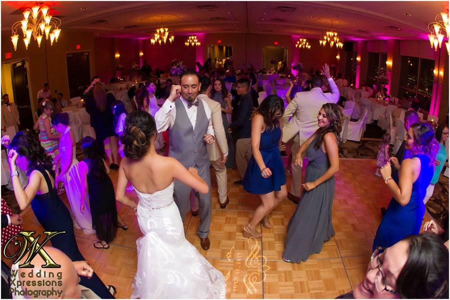 bride and groom dance during wedding at DoubleTree Hotel in El Paso