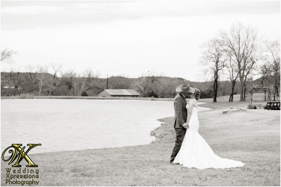 wedding couple at Thistle Springs Ranch lake