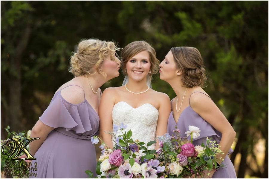 sisters kissing bride