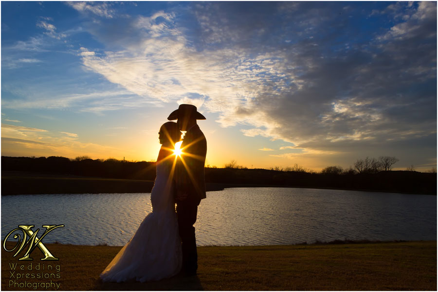 Thistle Springs Ranch lake silhouette of wedding couple