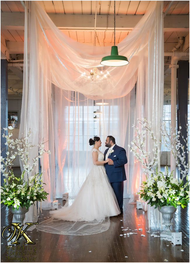 wedding ceremony at Epic Railyard Event Center by Wedding Xpressions Photography