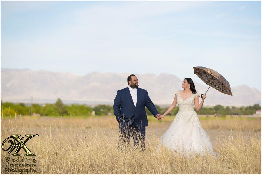 bride and groom with Louis Vuitton umbrella
