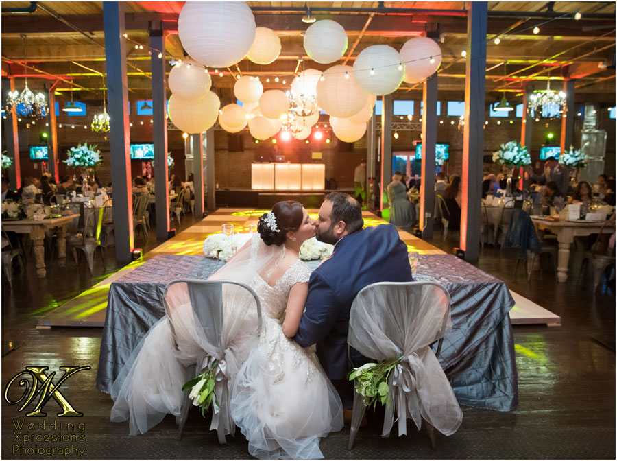couple kissing at Epic Railyard during wedding