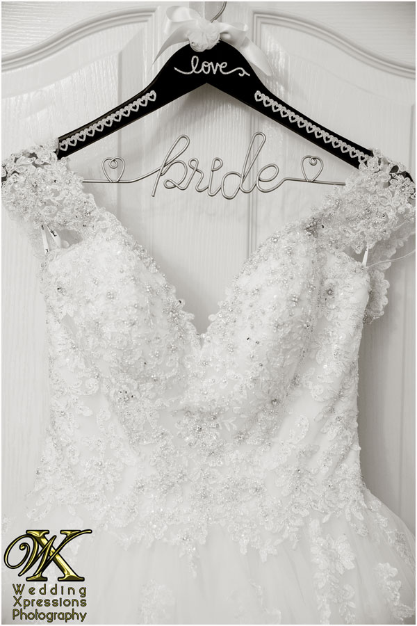 wedding dress with bride hanger