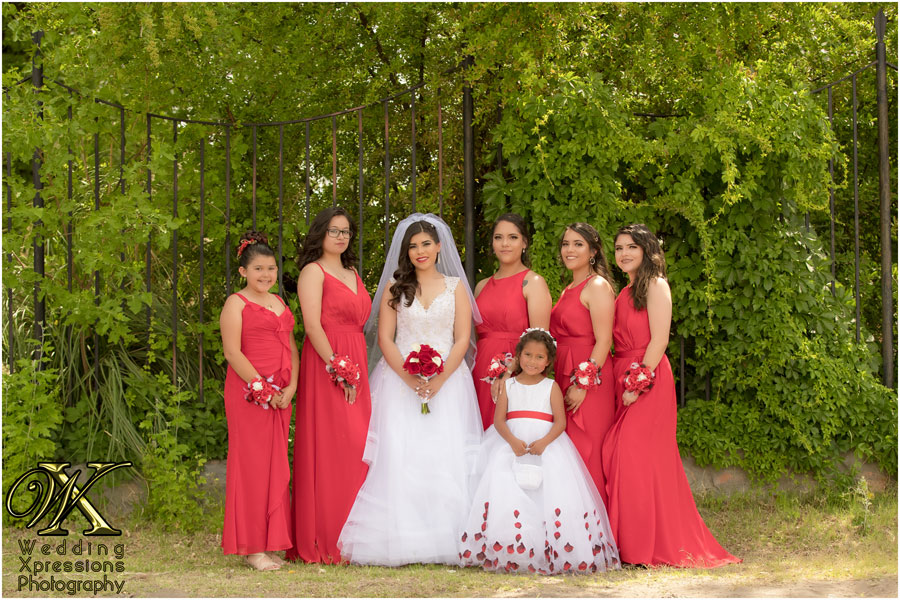 bride with bridesmaids with red dresses