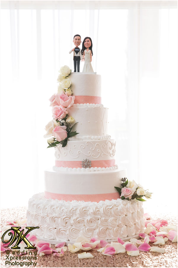 cake with bride and groom topper