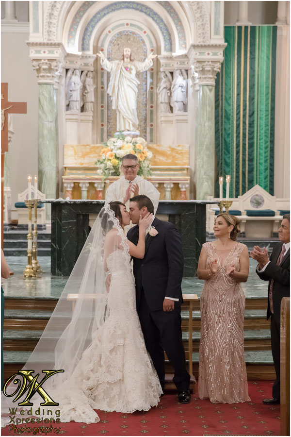 first kiss at wedding church ceremony