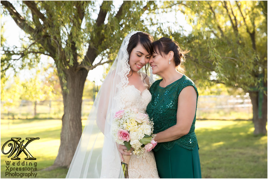 bride with mom on wedding day