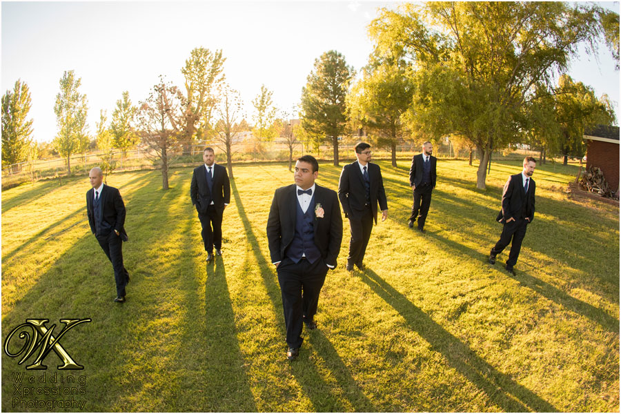 cool photography of groom with groomsmen at ranch