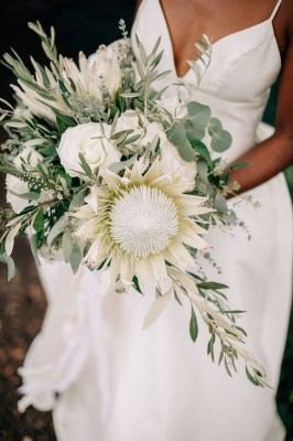 White and green wedding bouquet with protea