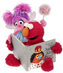 Elmo from Sesame Street reading