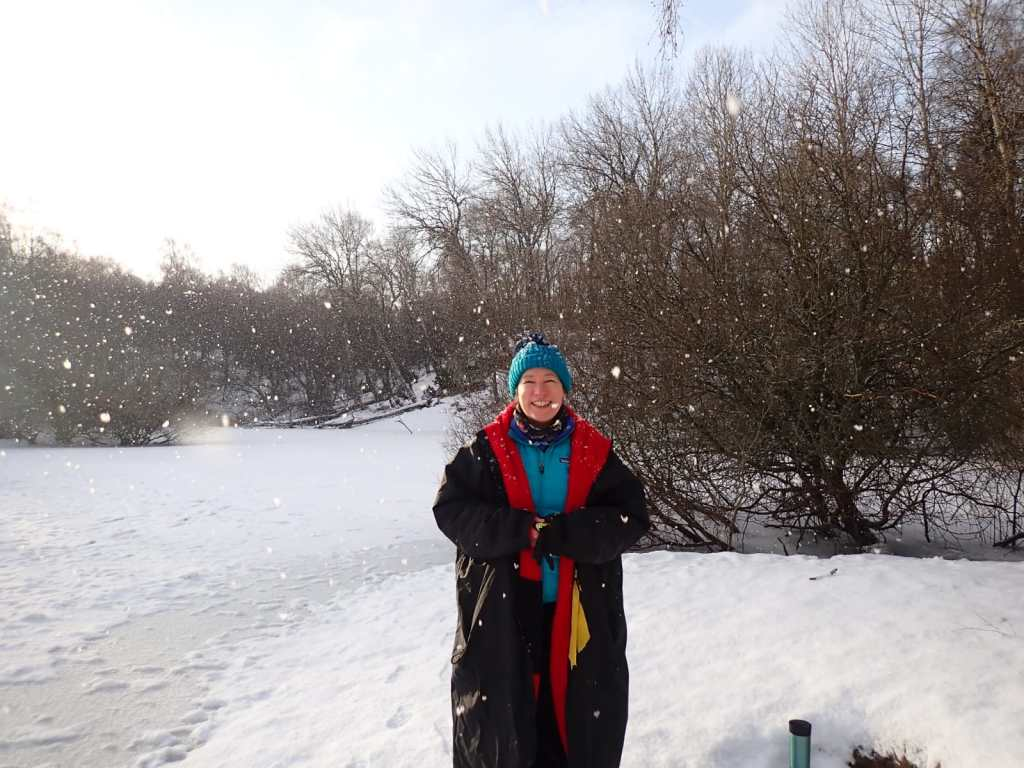 Cosy in dryrobe next to frozen loch