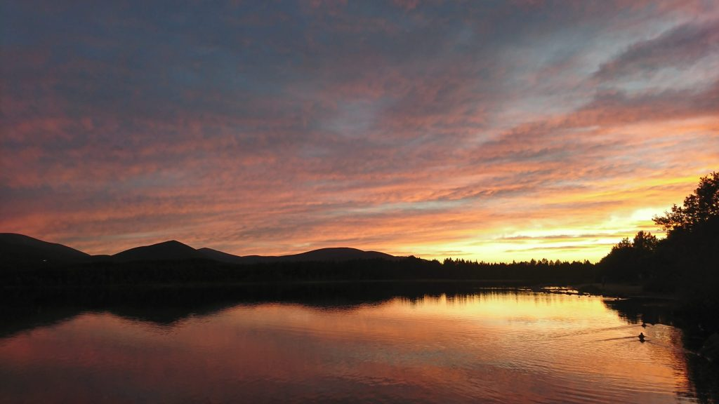 Loch Morlich looking like molten gold at sunset