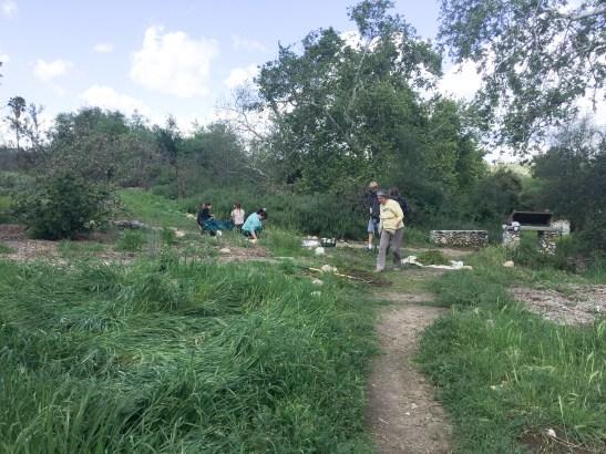 Volunteers for girl scout troop weed path