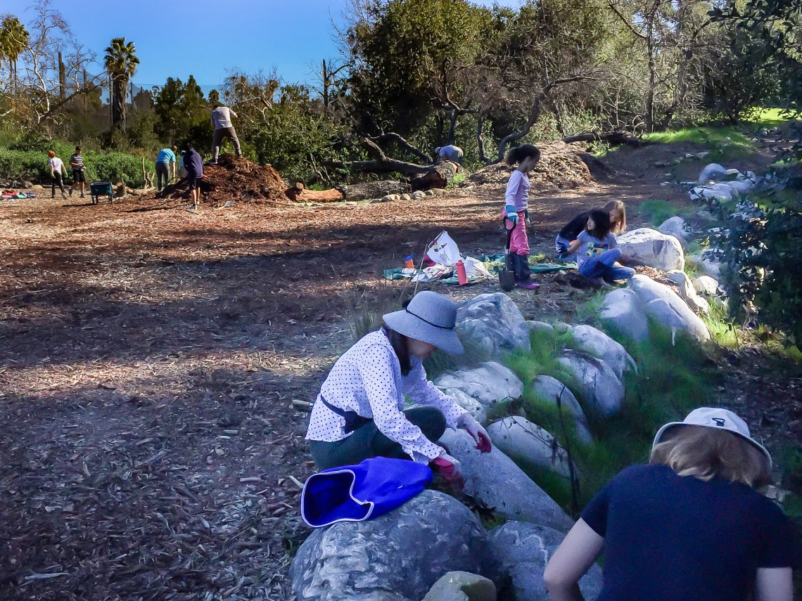 Volunteers working in park in February