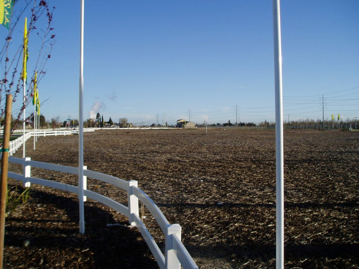 weed-mgmt-field-with-white-fence