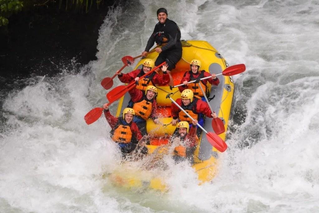 Group in rapids while rafting in rotorua on kaituna river