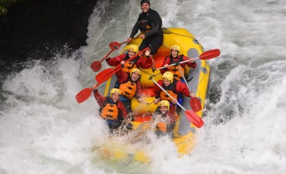 Group in rapids while rafting in rotorua on kaituna river