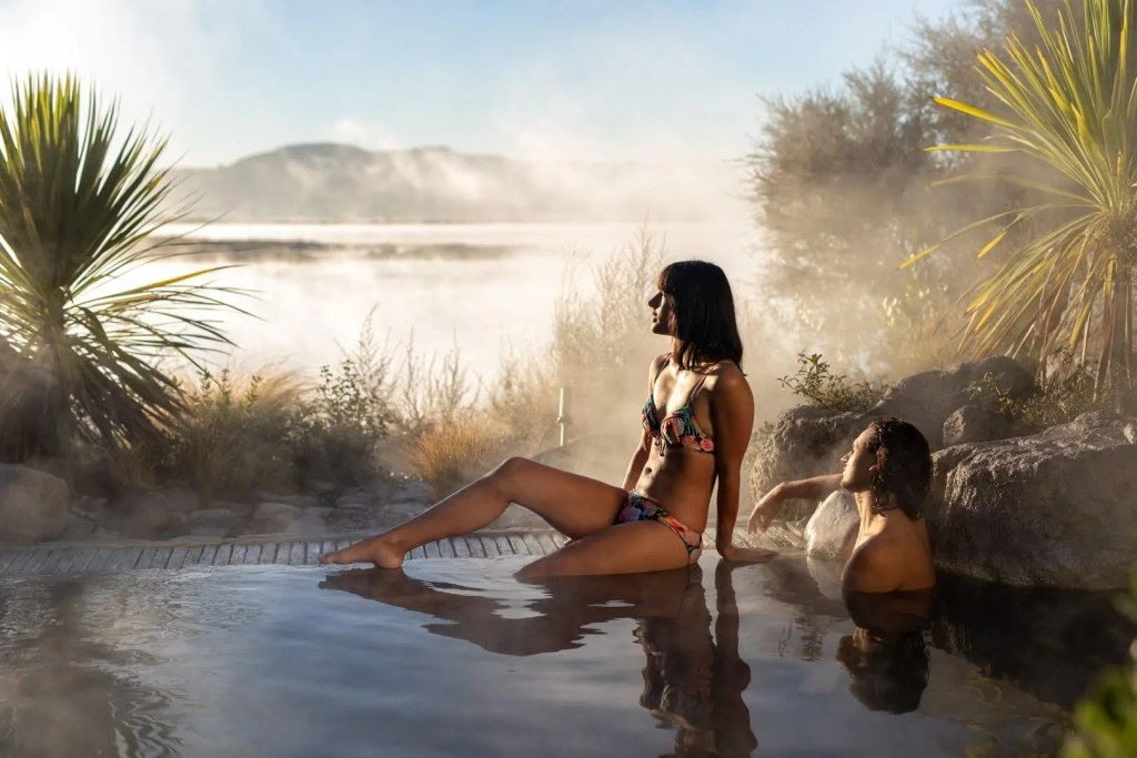 Couple overlooking Lake Rotorua at the Deluxe Lake Spa in Rotorua New Zealand