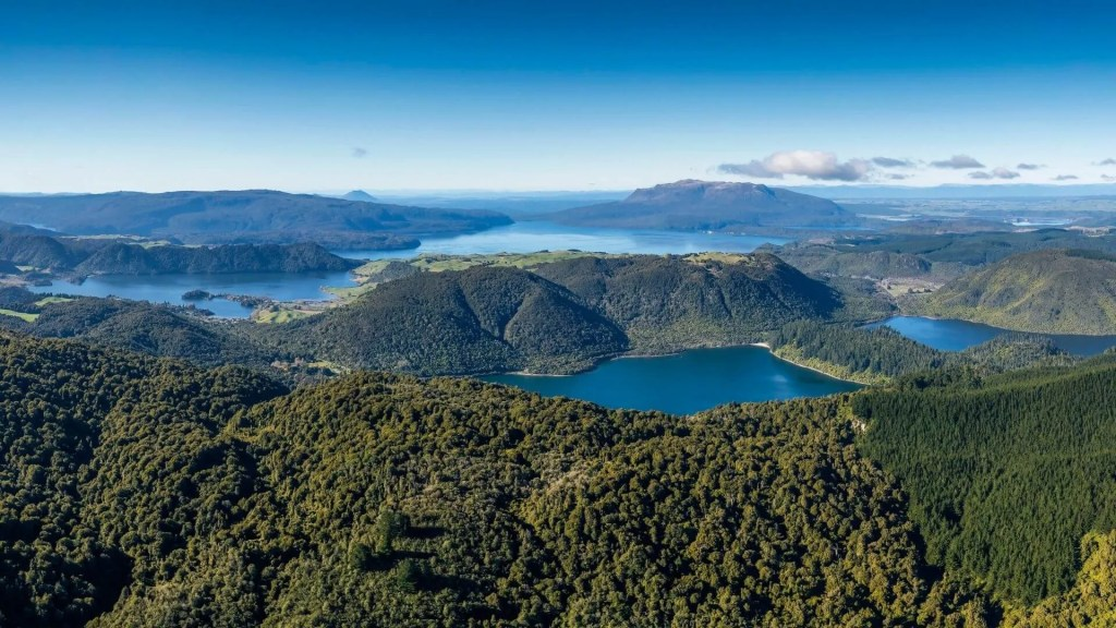 Aerial view of Mt Tarawera and Rotorua lakes by Volcanic Air