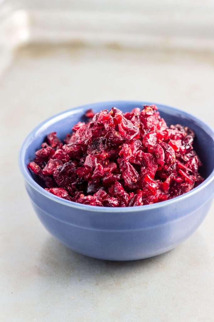 How-To Make Dried Cranberries in the Oven-A how-to guide on making dried cranberries at home using the oven. This allows you to control the sugar content for healthier snacking. Vegan & gluten free.