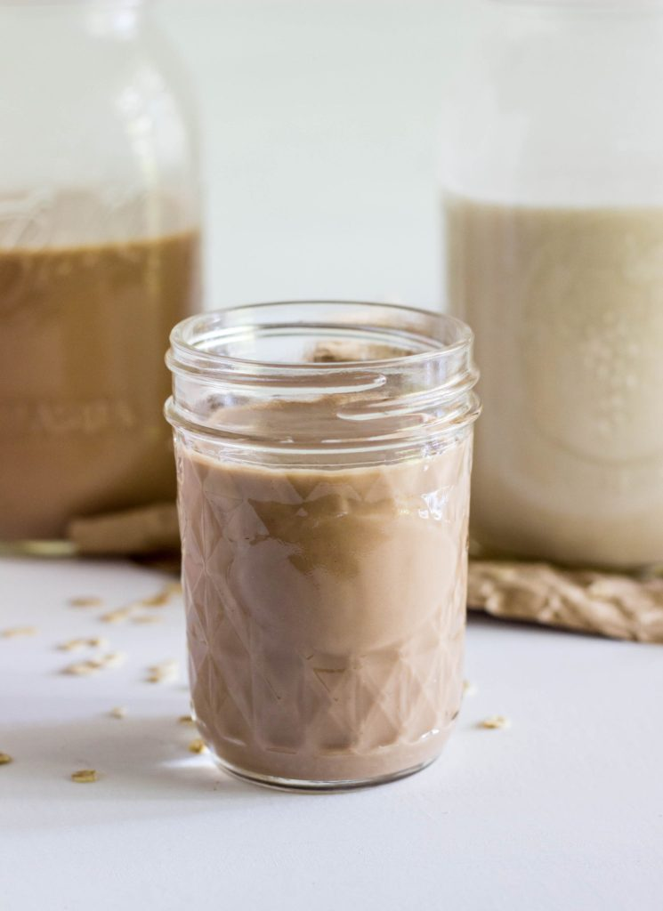 How To Make Oat Milk - A straight forward and simple guide to making homemade oat milk in 3 different flavors. Chocolate, Vanilla, and Strawberry. No artificial flavors or colors.