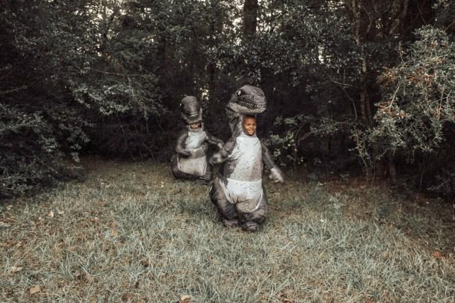 Boys dressed as velociraptors from Jurassic Park
