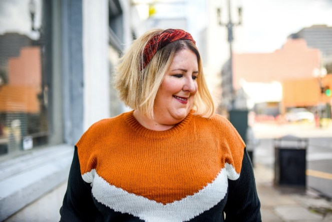 Orange Chic Soul sweater and faux leather leggings.