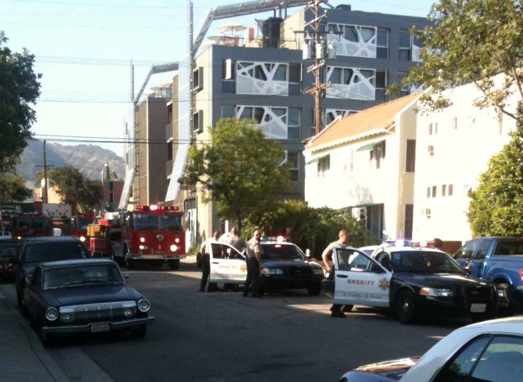 Sheriff and Fire Department vehicles on Sierra Bonita after a report of a drunk man attempting to set things on fire at the location. (Photo: Ian Ryerson for Weho Daily)