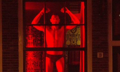 For the first time ever, Amsterdam displays male sex workers in its red light district windows