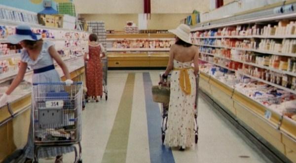 Prehistoric women gathering foodstuffs.