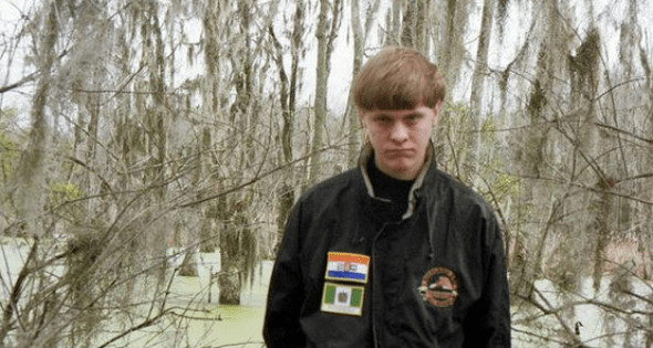 Dylann Storm Roof's Facebook profile picture; the patches on his jackket depict the flags of Rhodesia and apartheid-era South Africa