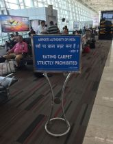 Airport sign in India Eating carpet strictly prohibited