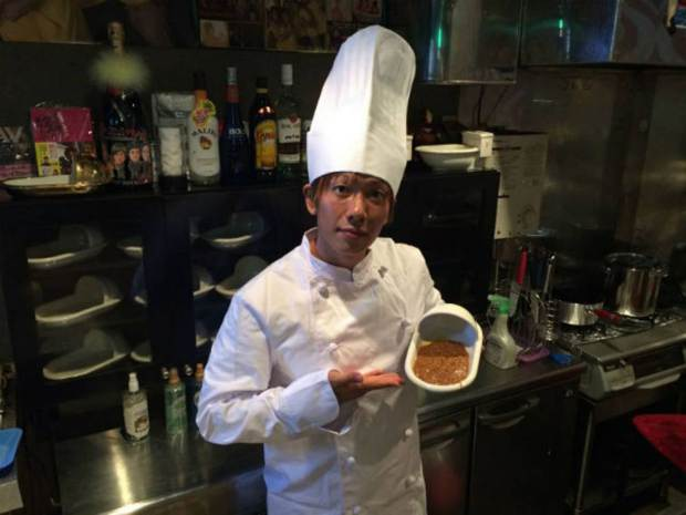 Chef holding his poop-flavored curry