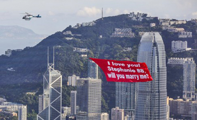 Marriage proposal on helicopter banner