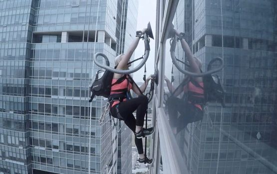 Woman Scales Skyscraper Using Only A Vacuum