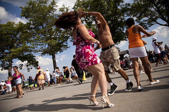 Lauren DeCicca for The Wall Street Journal Virgin Mary Rossas, 45, and Reinaldo Komen, 48, salsa dance at Orchard Beach.