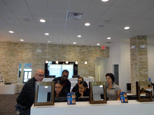 General Manager John Bozio is seen here training staff at the newest location / Courtesy Metro Optics Eyewear Facebook Page