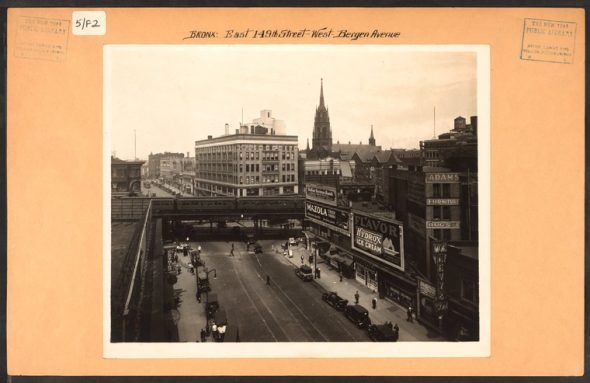 """Also taken in 1926, this image of 149th Street and The Hub in Melrose looking West with Immaculate Conception Church standing as the tallest structure for miles. / Image Credit: Irma and Paul Milstein Division of United States History, Local History and Genealogy, The New York Public Library. """"Bronx: 149th Street (East) - Bergen Avenue"""" The New York Public Library Digital Collections. 1926."""